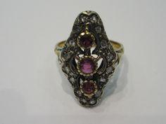 Anello vintage in oro giallo e argento con diamanti cava vecchia e rubini