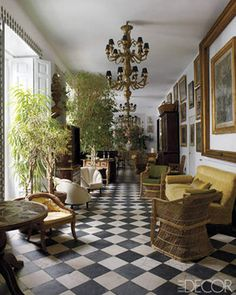 18th-century black slate and marble tiles create a stunning checkerboard floor in this Madrid, Spain, home.