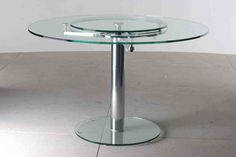 Contemporary glass dining table with pop-up lazy susan.  #table #furniture #glass
