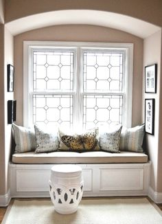 Miles Design Group- Stair Landing,  Cushion - Custom in Indoor/Outdoor Fabric,  Pillows - Pottery Barn,  Rug - Pottery Barn,  Stool - ZGallerie