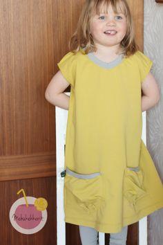 College dress to 3-year old child. Made of Nosh Organics organics cotton college.