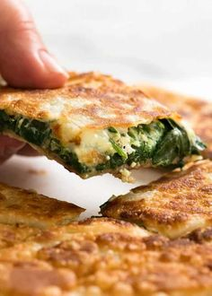 Hand picking up piece of Spinach and Feta Gozleme Spinach Recipes, Beef Recipes, Cooking Recipes, Healthy Recipes, Healthy Food, Samosas, Gozleme Recipe, Turkish Recipes, Ethnic Recipes