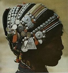 Not really Indian, but the ornaments on this headdress looks like some of the kuchi pieces in India