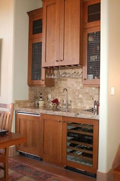 Wet bar with stone backsplash.