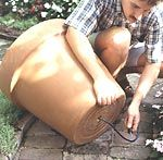 Directions for making a fountain out of a large flower pot (via Better Homes  Gardens)