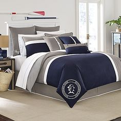Sail away to dreamland every night with the classic Southern Tide Starboard Comforter Set. Reminiscent of nautical flags, the handsome bedding features a maritime-inspired design in navy, nautical grey and white.