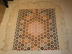 "Applique and patchwork coverlet with flounce and fringe. Honeycomb patchwork pieces .75"" hexagons. ca. 1850"