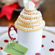 Give each party guest her own personalized drink mug by attaching a piece of colored paper to the mug handle with jingle bells and ribbon. For extra show, place a cookie tree on top of the mug that looks almost too good to eat!/