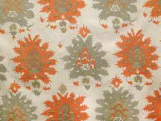 Tunisia Linen Fabric Hand printed Orange and Grey Large floral design on Taupe Linen. Suitable for Curtains. Minimum order of 5 metres.