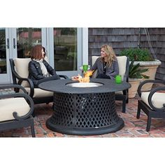 """The Lombok Gas Fire Pit Chat Group from Patio Sense is constructed of cast aluminum with our unique antique bronze finish. This set includes four arm chairs with back and bottom beige outdoor cushions and a 53"""" round gas fire pit."""