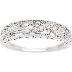 Vintage detailing is complemented by lovely white diamonds in this 10-karat white gold ring, making it a perfect way to commemorate the lasting vows of love you have made for someone else. The piece h