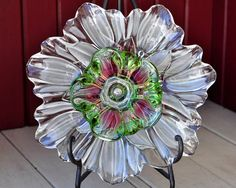 This gorgeous glass garden flower is made with multiple layers of pristine vintage glass and crystal. You can display this flower multiple ways. It