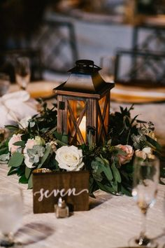 chic vintage wedding centerpiece ideas with lantern centerpieces vintage 34 Chic Wedding Decoration Ideas with Lanterns on A Budget - EmmaLovesWeddings Lantern Centerpiece Wedding, Vintage Wedding Centerpieces, Wedding Lanterns, Wedding Flower Arrangements, Centerpiece Ideas, Winter Table Centerpieces, Vintage Weddings, Vintage Decoration Wedding, Centerpieces For Weddings