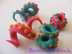 www.facebook.com/dinowsdreadbeads  Custom or pre-made dread beads handmade of polymer clay.  keywords: dread dreads bead beads coil tentacle coral swirl octopus polymer clay