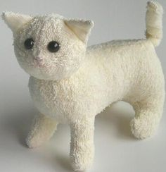 Turn old towels into sweet, adorable toy kitties with this terrycloth stuffed cat tutorial!