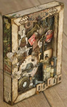 Hi Everyone, I am here today to share with you all a little more Tim Holtz inspired creativeness. This is the first reverse canvas I have...
