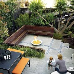 Built-in bench seating and bold colors bring a designer look in this chic urban yard. Check out our gallery of back yard photos and find solutions to tackle your small space: http://www.landscapingnetwork.com/landscaping-ideas/small-yard/design.html# Photo from Sunset.com. Like the benches