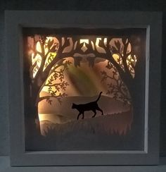 A stunning and unique 4 layer papercut light box depicting your pets silhouettes at Rainbow Bridge  I can add any pets to this 3d image, please add a message with your requirements at checkout.  The light is operated by Battery powered LEDs and the pack is very thin and sits behind the frame for wall mounting.  Black, White or Natural 8x8 inch box frame   …………………………………. C R A F T S M A N S H I P ∙ & ∙ L O V E  - Handmade with love and care to order  …………………………………. C U R R E N T ∙ P R O D ...