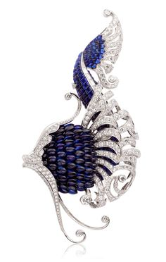 Illiade clip, L'Atlantide collection, Van Cleef & Arpels.  White gold, Mystery Set™ sapphires, diamonds.