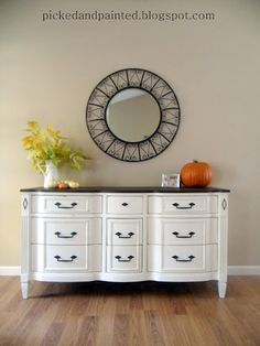It would be so cool to get an older chest-of-drawrs and stain the top to match the crib and paint the bottom white like this and use it for a Changing Table