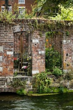 ~ walled garden and courtyard ~ on a riverbank in Winchester ~  Hampshire ~ England ~ UK ~