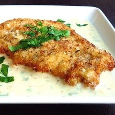 Chicken Milanese with Lemon Cream - Crisp breaded chicken cutlets in a creamy sauce with wine, sage and lemon. Amazing!