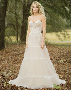 Lillian West lillian west style 6451 The lace appliques, trimmed tiers, and soft skirt make this gown unique. A sweetheart neckline, natural waistline, and chapel length train complete the look. Boho Wedding Dress, Chic Wedding, Boho Dress, Bridal Dresses, Wedding Styles, Wedding Gowns, Prom Dresses, Elegant Wedding, Wedding Stuff