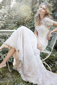 For the princess bride seeking a slim silhouette, the Daphne gown is an exquisite lace A-line gown features a jeweled neckline and detachable keyhole coverlet artfully adorned with scalloping beaded patterns and Swarovski crystals @maggiesottero