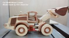 DEUK SUL KIM A out standing wood toy maker