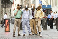 Not sure I can think of a better caption than a simple description: four horse headed people found on Wall Street.