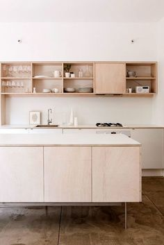 Plywood kitchen built-ins via the design files.