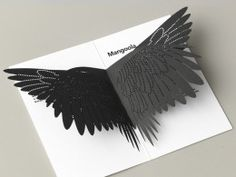 Creating invites that are intricately laser cut paper into wings representing the Cockatoo wings, two large foil block stamps were created from a pattern representing not only the texture of the wings but the layers of the earth of an open cut coal mine.