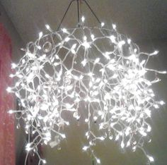 just for fun, a chandelier I made by wrapping Christmas lights around an old lampshade frame (or use a wreath frame or even a hula hoop) and hanging it from the ceiling.