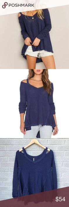 """Free People Moonshine V Cold Shoulder Sweater Free People Moonshine V Cold Shoulder Sweater in Atlantic Blue! Honeycomb texture cold shoulder & love the Raw hems! Oversized look! Perfect to layer. Size XS. 21.5"""" Long in front & 25"""" in Back. 19.5"""" across the chest. Previously loved has a small hole on right shoulder. Please see photos. KG2549110517 Free People Sweaters V-Necks"""