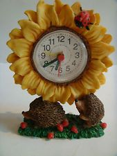 LOVELY SUNFLOWER CLOCK WITH HEDGEHOGS CARRYING