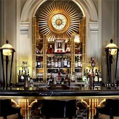 Art deco lounge - gray walls with gold and black details. The Palm Court Tea Room & Bar, Sheraton Park Lane Hotel,  London.