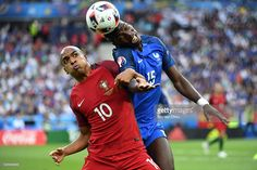 João Mário of Portugal clashes with Paul Pogba of France during the UEFA EURO 2016 Final match between Portugal and France at Stade de France on July 10, 2016 in Paris, France.