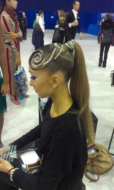 High ponytail with a swirl accent and rhinestones. Great hairstyle for latin if you can tame the hair and keep it out of your eyes! Visit http://ballroomguide.com/comp/hair_make_up.html for more hair and makeup info