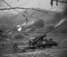 155 mm Long Tom's firing on enemy positions.
