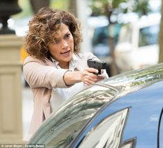 Fierce! Jennifer Lopez looked quite the seasoned pro as she got into character on set of new flick Shades of Blue in New York on Wednesday