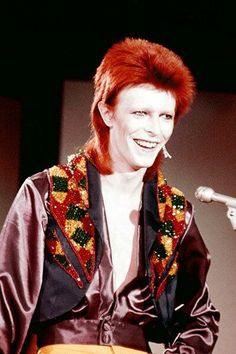 Snow white tan  flaming red hair. Gorgeous! #bowie