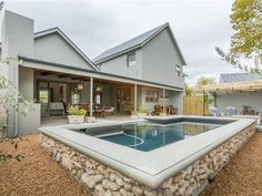 4 Bedroom House in Die Boord, LOCATION AND SCHOOLS   This Beautiful Cape Vernacular offers high ceilings and fantastic flow onto the patio and braai overlooking the pool with a mellow and relaxing atmosphere.  This home offers a s...