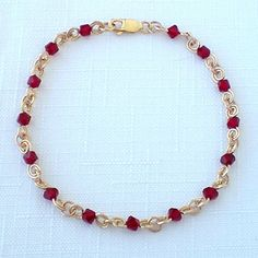 July Birthstone Bracelet- Ruby is the birthstone for the month of July. Traditionally rubies are a symbol of success and integrity and were thought to ward off evil and ill-health. This bracelet is hand-made with 14kt gold fill and Swarovski® crystal. A great gift for birthdays, graduations, Mother's Day, wedding parties and bridesmaids, and other special occasions. Approximately 7 inches in length. $25.00