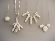 this is porcelain, but bet I could do this in polymer or air-dry white clay - the one on the left looks very similar to a turquoise polymer clay recipe I pinned earlier.  The white is very elegant!