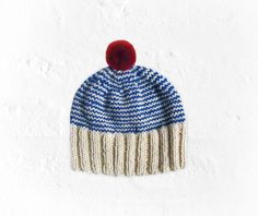 Knitted handmade hat with blue and natural white wool stripes and red pom pom unisex on Etsy, $35.00