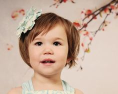 sweet little girl with a brown hair in a bob and brown eyes