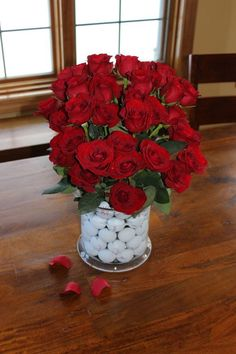 A milestone centerpiece!  Golf themed centerpiece.   Made with 50 golf balls and 50 red roses.