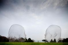 Irma- 50-metre curtain of wavering poetry made of suspended steel letters to see giant wire-frame heads, through which the landscape is visible. The sculptures rest contemplatively on the grass lawns, integrating with the land without being apart from it.