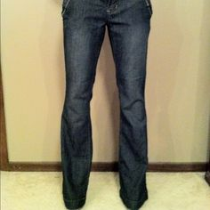 """Rewash Flare Denim Medium Blue NWOT Medium blue light weight stretchy flared denim. Belt loops with button decals on them. Very dark brown and tan stitching. Zippered back pockets. Zipper & hook closure. No noted defects. Measurements are taken with item laying down flat & are approximate but I try my best. Hips 15.25"""", front rise 7.75"""", back rise 11"""", upper thigh 8.75"""", inseam 32"""", leg opening 11"""". Machine washable. 74% cotton, 24% polyester, 2% spandex. Rewash Jeans"""