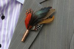 unique boutonnieres for grooms handmade weddings by Etsy fall feathers- This is Chels's favorite